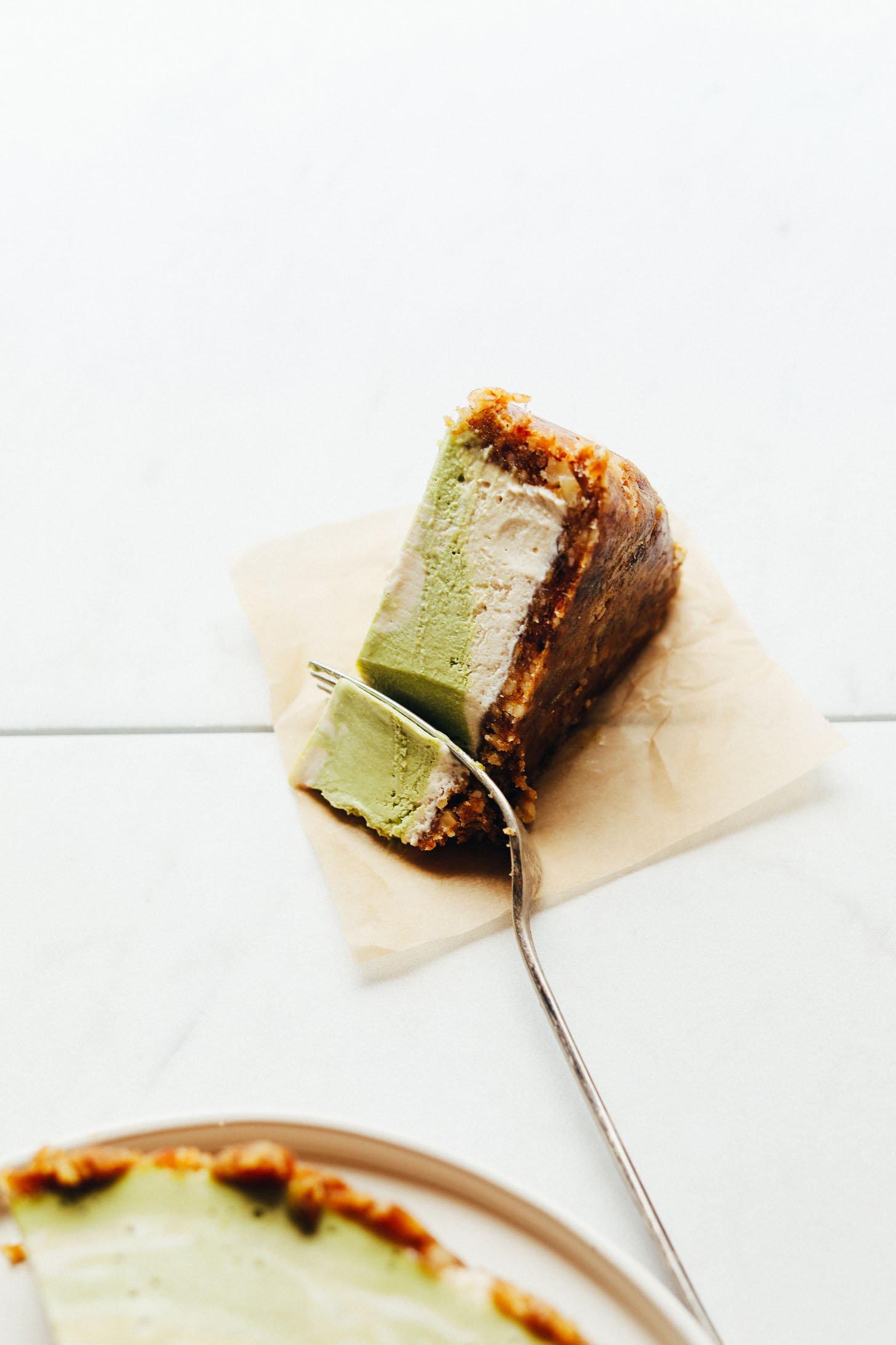 AMAZING Matcha Swirl Cheesecake! 1 blender, simple, naturally sweetened, SO delicious! #matcha #cheesecake #recipe #vegan #glutenfree #minimalistbaker