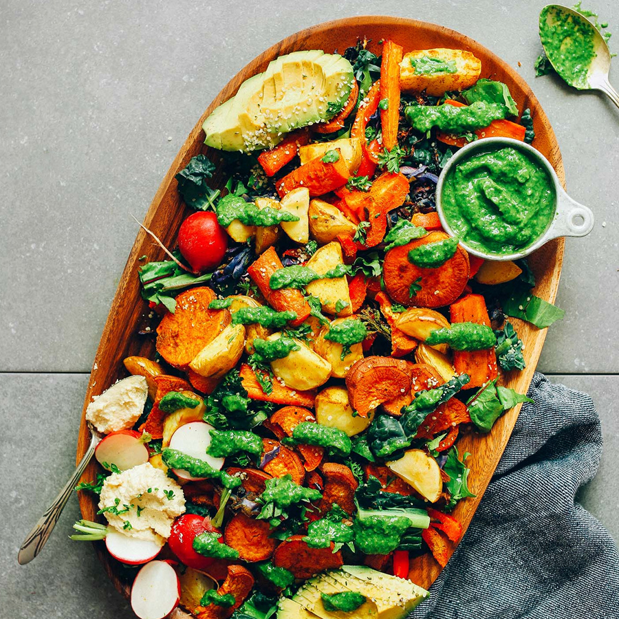 Chimichurri with roasted vegetables for our roundup of 16 Vegan Entrees for Stress-Free Cooking