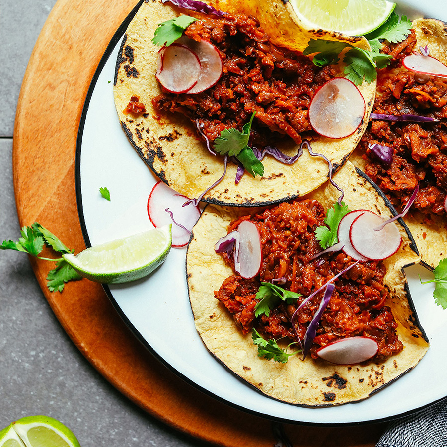 Plate of Vegan Barbacoa tacos for our recipe roundup of 16 Vegan Entrees for Stress-Free Cooking