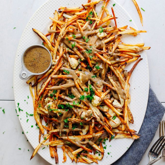 Large white ceramic platter with our amazing Vegan Poutine recipe