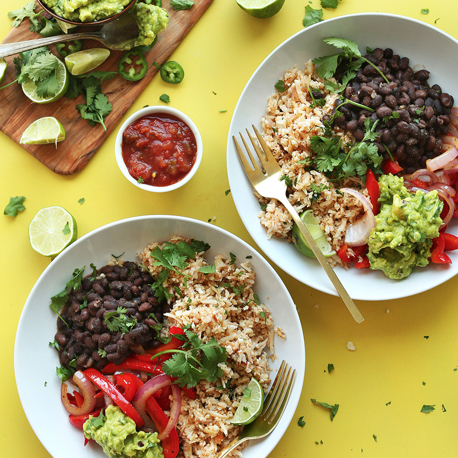 Two big bowls filled with our Cauliflower Rice Burrito Bowl recipe