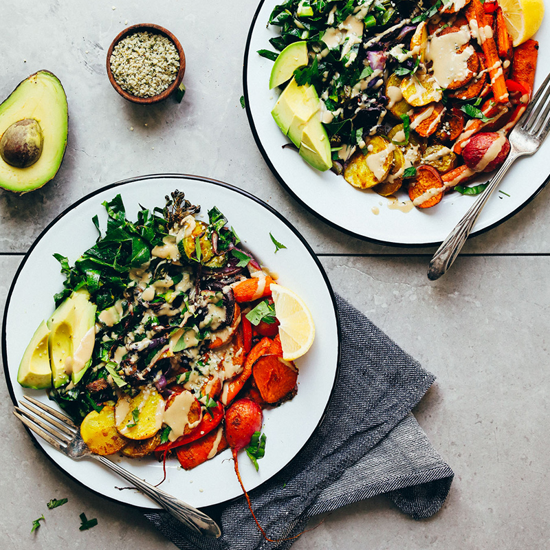 Forks resting on Roasted Rainbow Veggie Bowls as part of our roundup of 10 Healthy Vegan Weeknight Dinners
