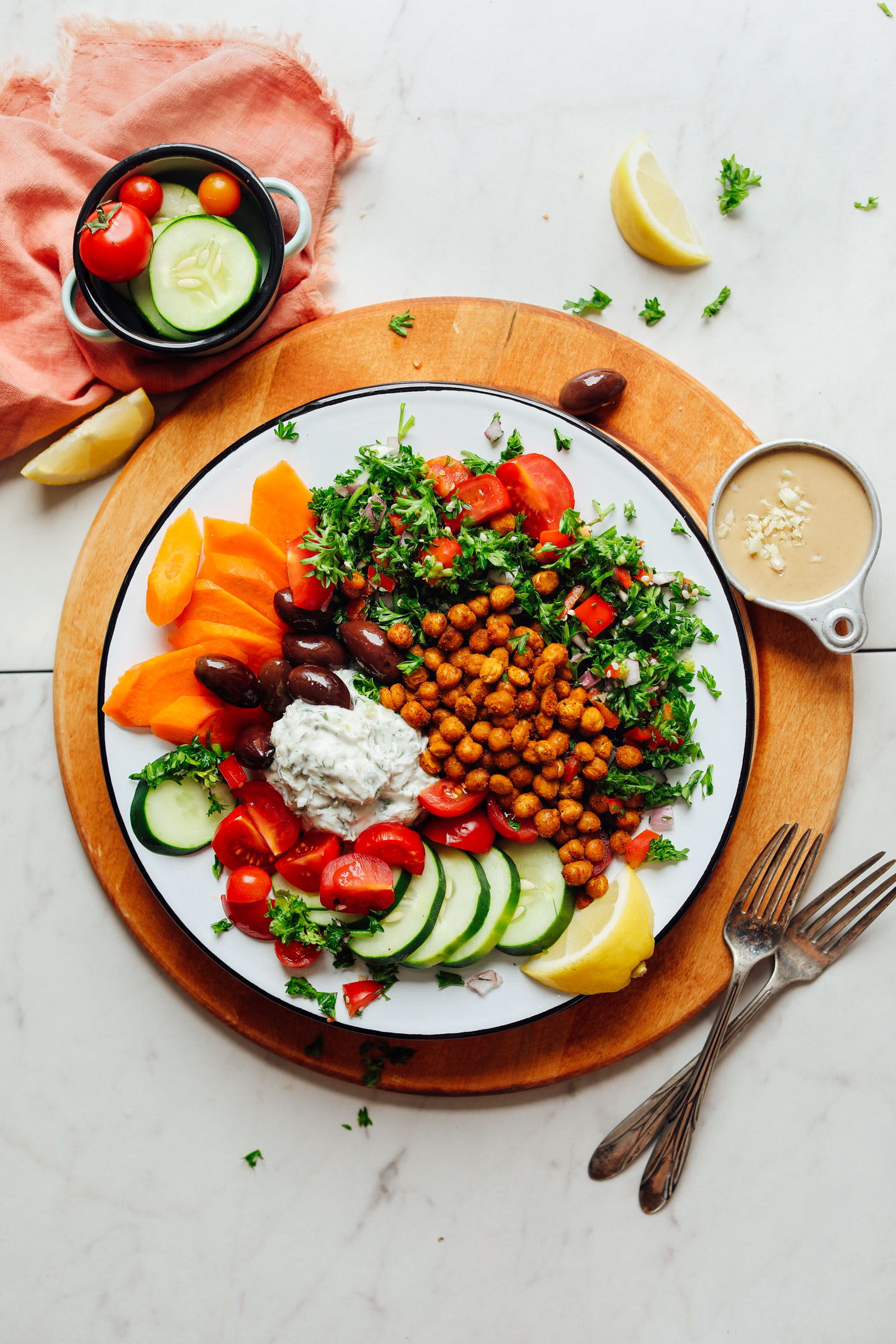 Plate filled with our Vegan Greek Bowl with Crispy Chickpeas, Vegan Tzatziki, and Veggies