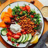 Large serving of our gluten-free Vegan Greek Bowl with Crispy Chickpeas, Vegan Tzatziki, and Veggies