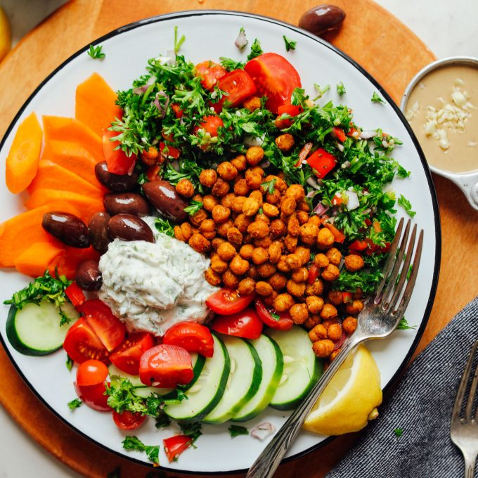 Large serving of our gluten-free Vegan Greek Bowl with Crispy Chickpeas, Vegan Tzatziki, and Veggies