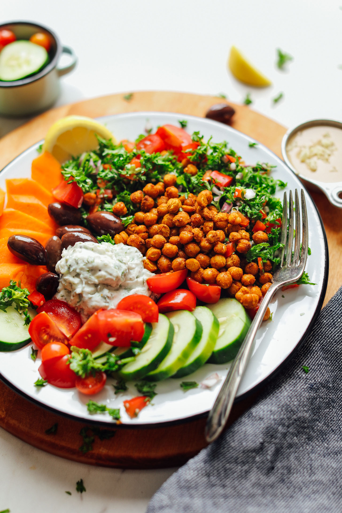 Close up shot showing the colorful ingredients in our Vegan Greek Bowl with Crispy Chickpeas, Vegan Tzatziki, and Veggies