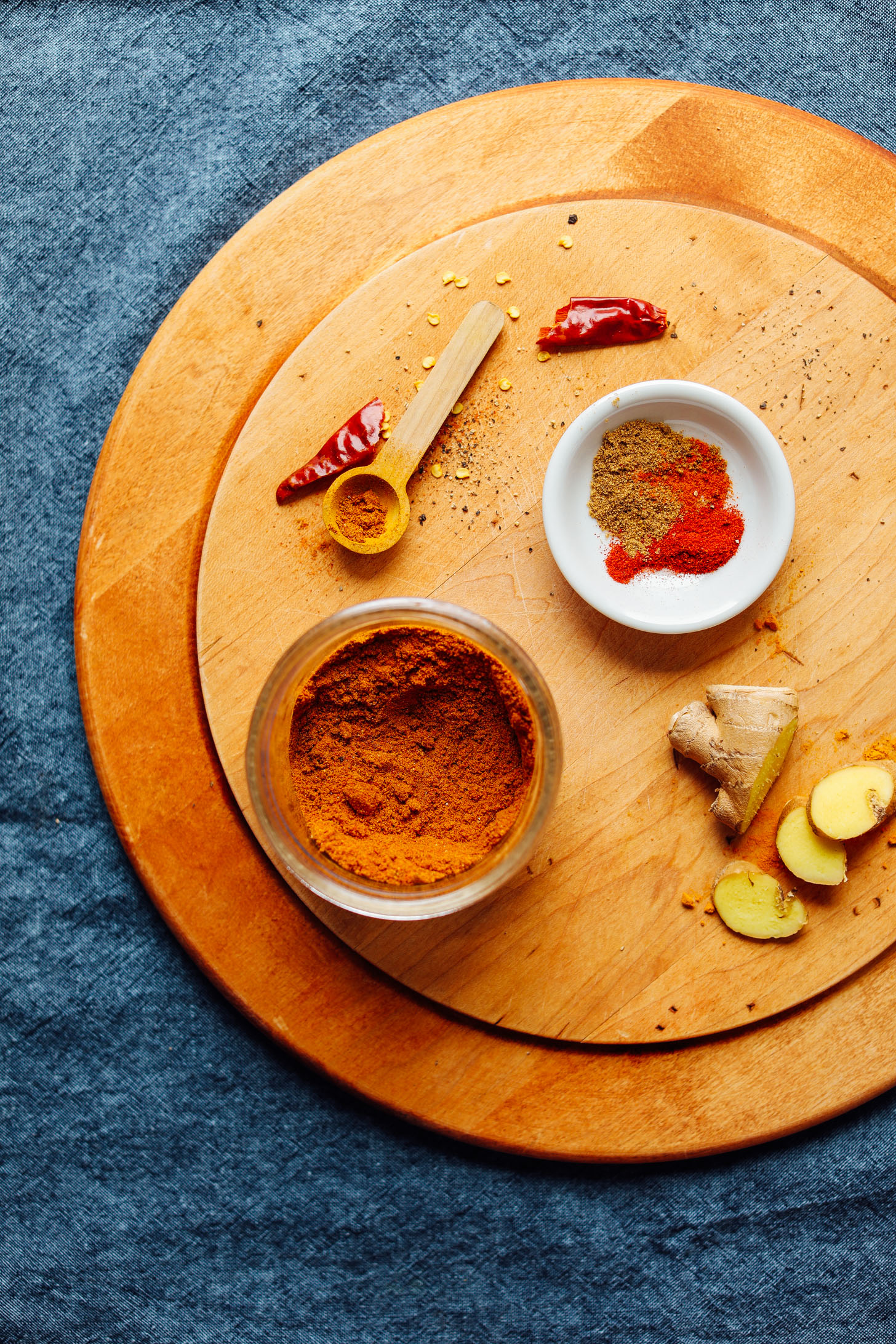 Cutting board with spices for making our DIY Shawarma Spice Blend