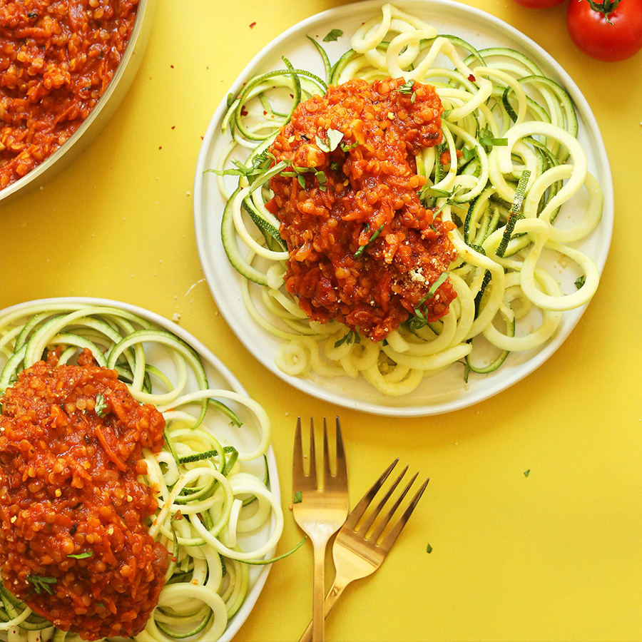 Plates of Zucchini Pasta with Lentil Bolognese for our recipe roundup of 16 Vegan Entrees for Stress-Free Cooking