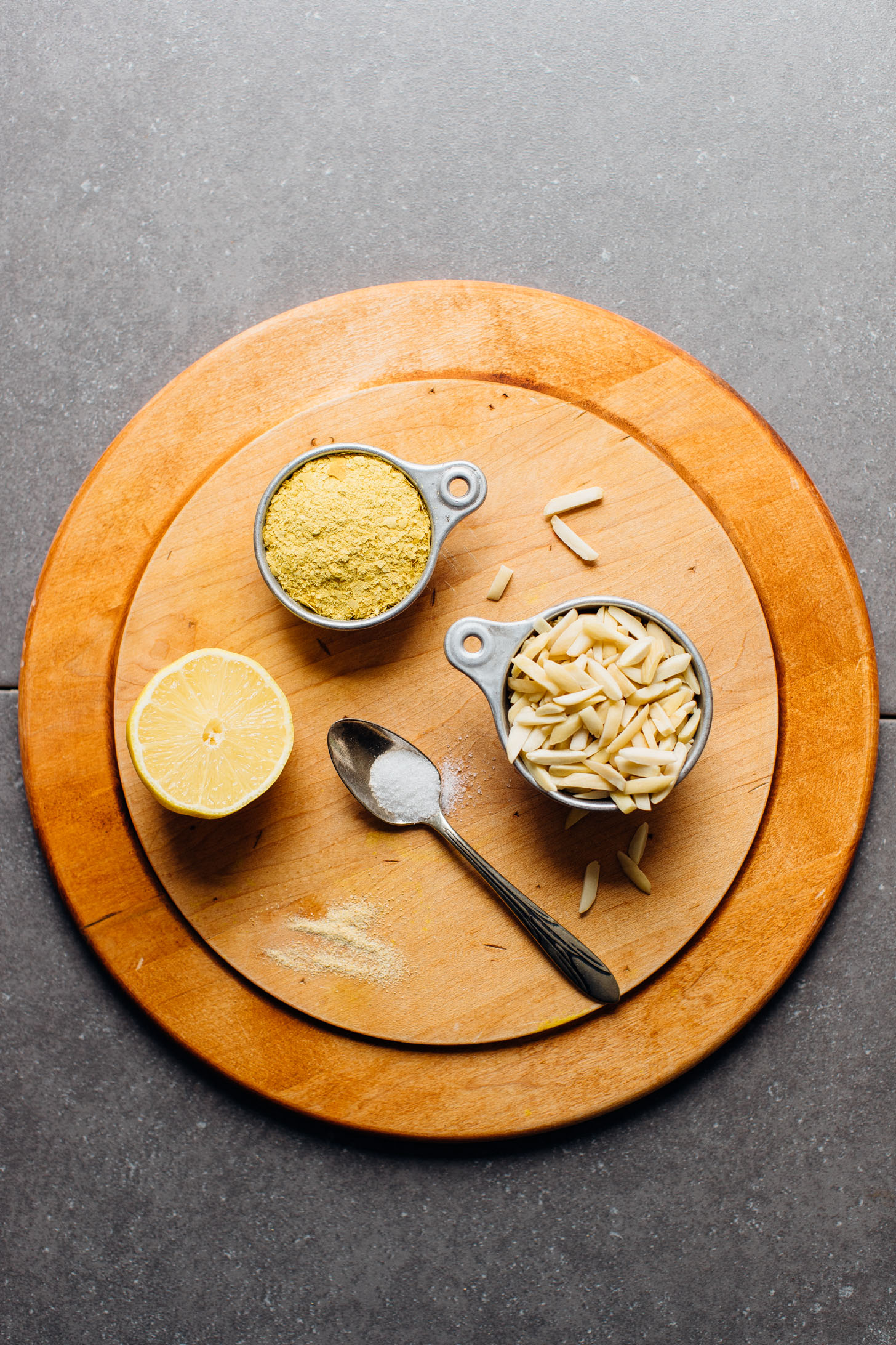 Nutritional yeast, lemon, salt, almonds, and garlic powder for making Vegan Ricotta Cheese