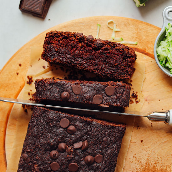Slicing into a loaf of Chocolate Zucchini Bread