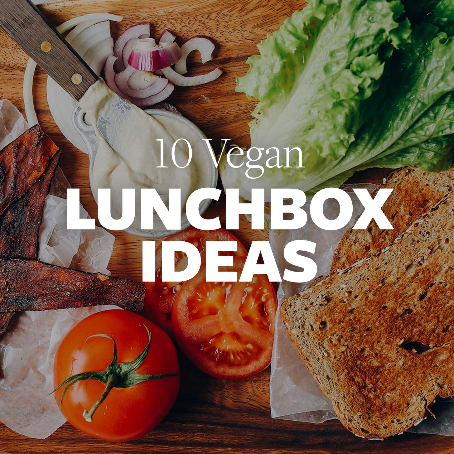 Sandwich fixings on a wood cutting board for our 10 Vegan Lunchbox Ideas roundup