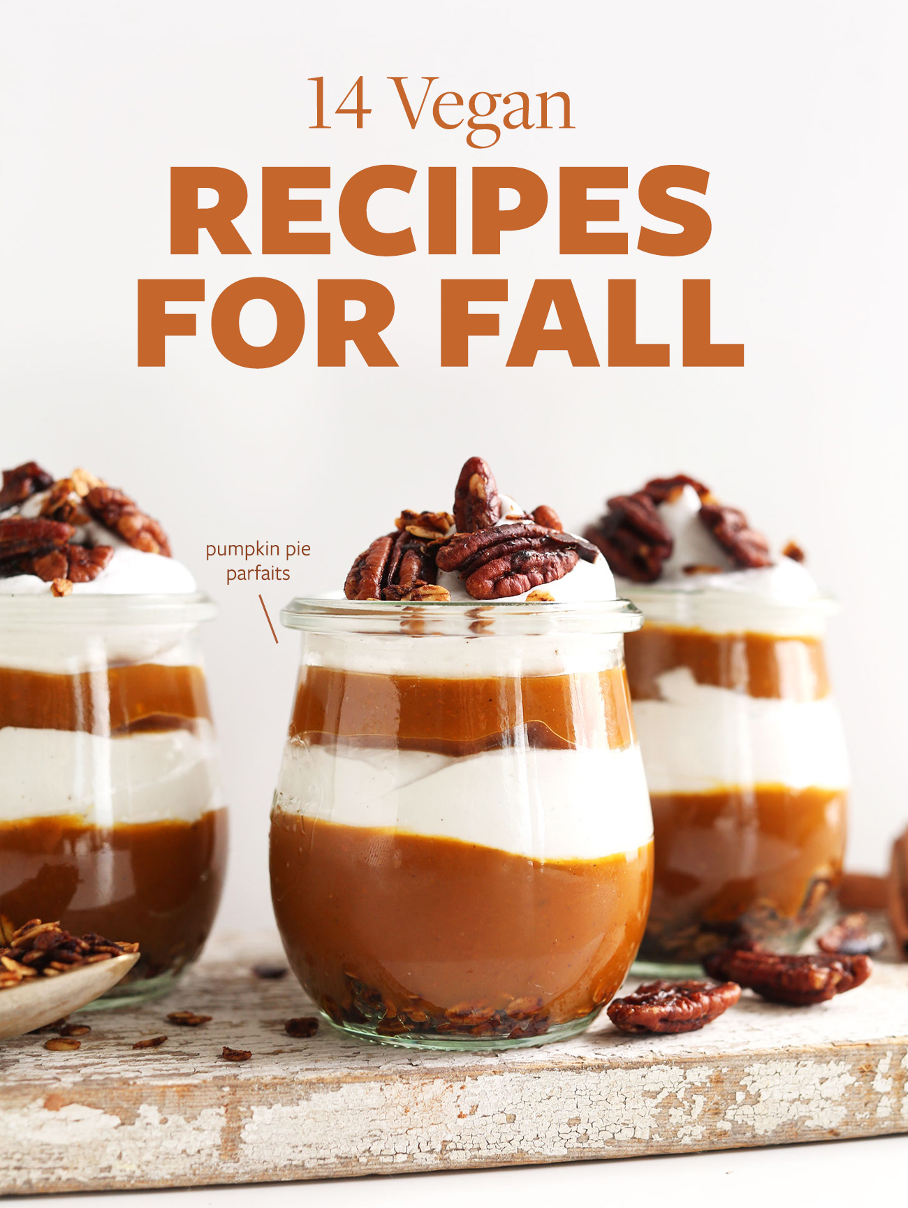 Pumpkin pie parfaits on a wood plank for our 14 Vegan Recipes for Fall roundup