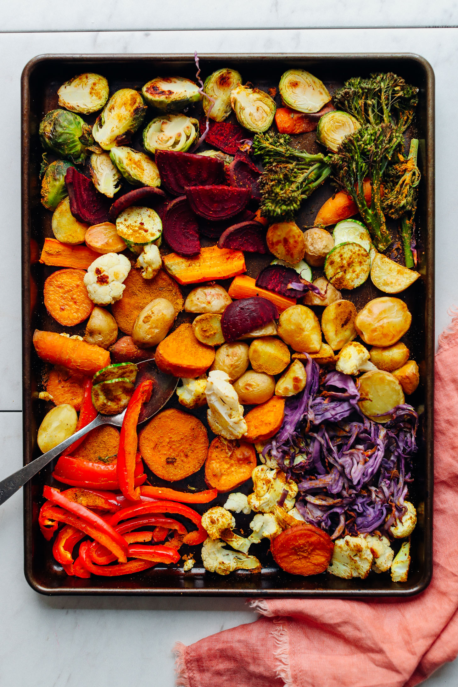 Baking tray filled with a bounty of freshly roasted vegetables