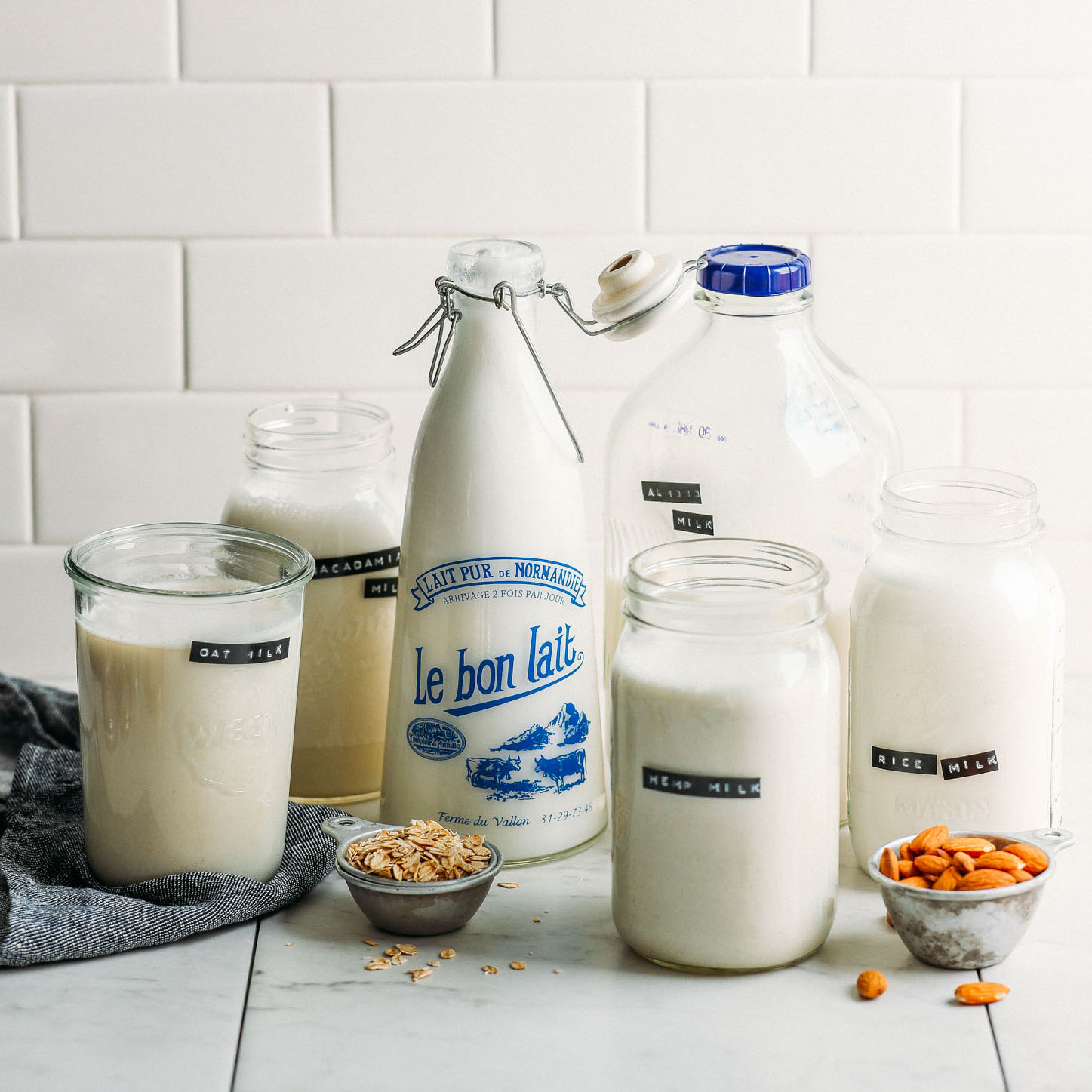 Jars of assorted types of homemade dairy-free milk