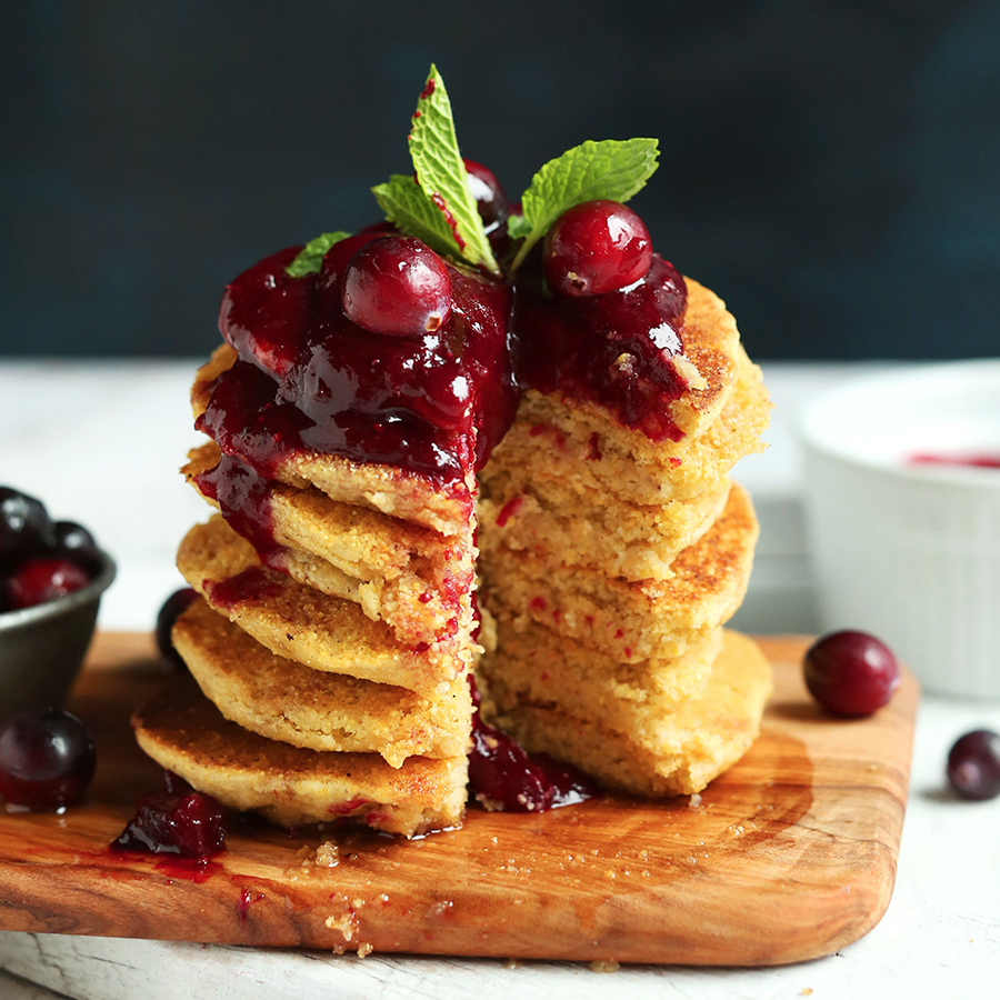 Stack of Cornmeal Pancakes topped with Cranberry Compote for our roundup of Vegan Recipes for Fall