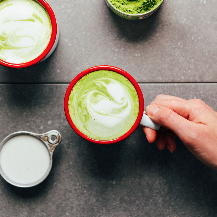 Holding a mug of matcha for our Vegan Recipes for Fall roundup
