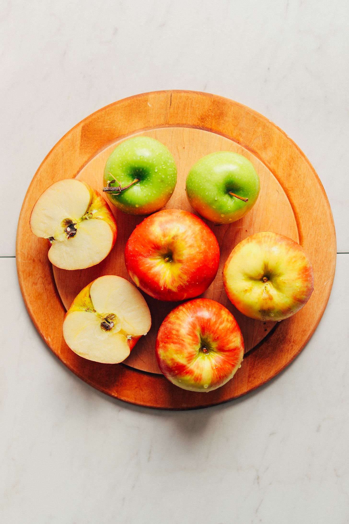 Wood cutting board with two varieties of fresh apples