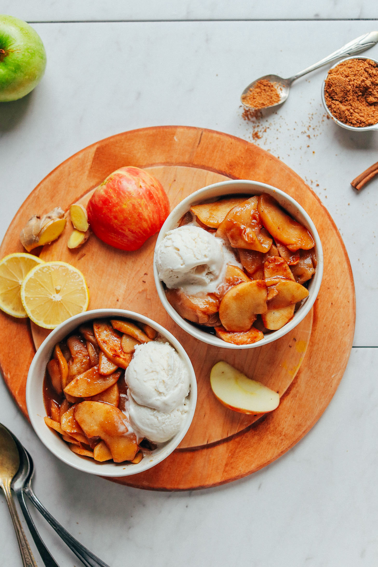 Two serving bowls with Cinnamon Baked Apples and vegan ice cream