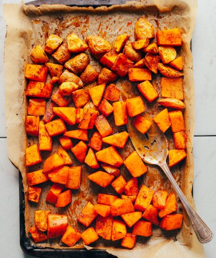 Parchment-lined baking sheet filled with freshly roasted butternut squash for our How to Make Roasted Vegetables recipe