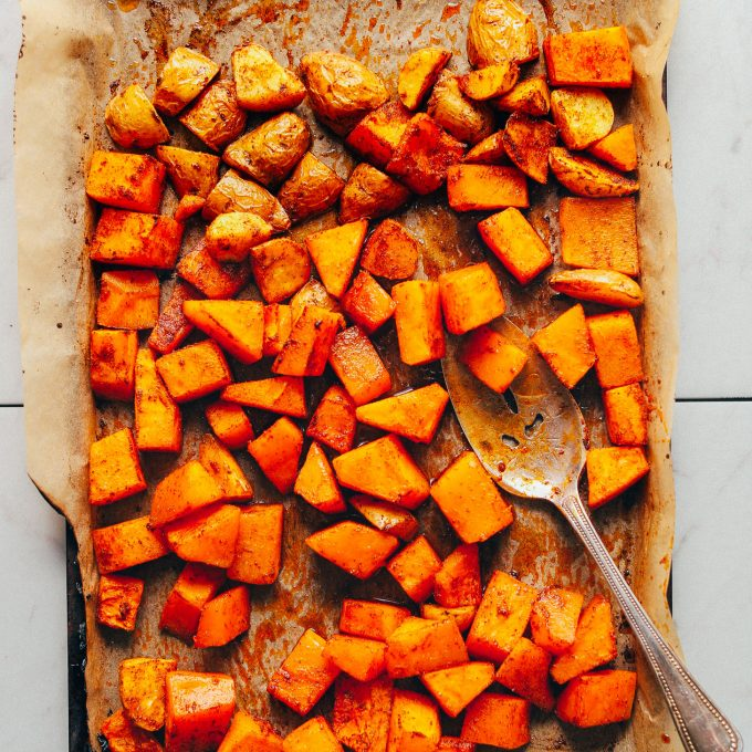 Parchment-lined baking sheet filled with freshly roasted butternut squash