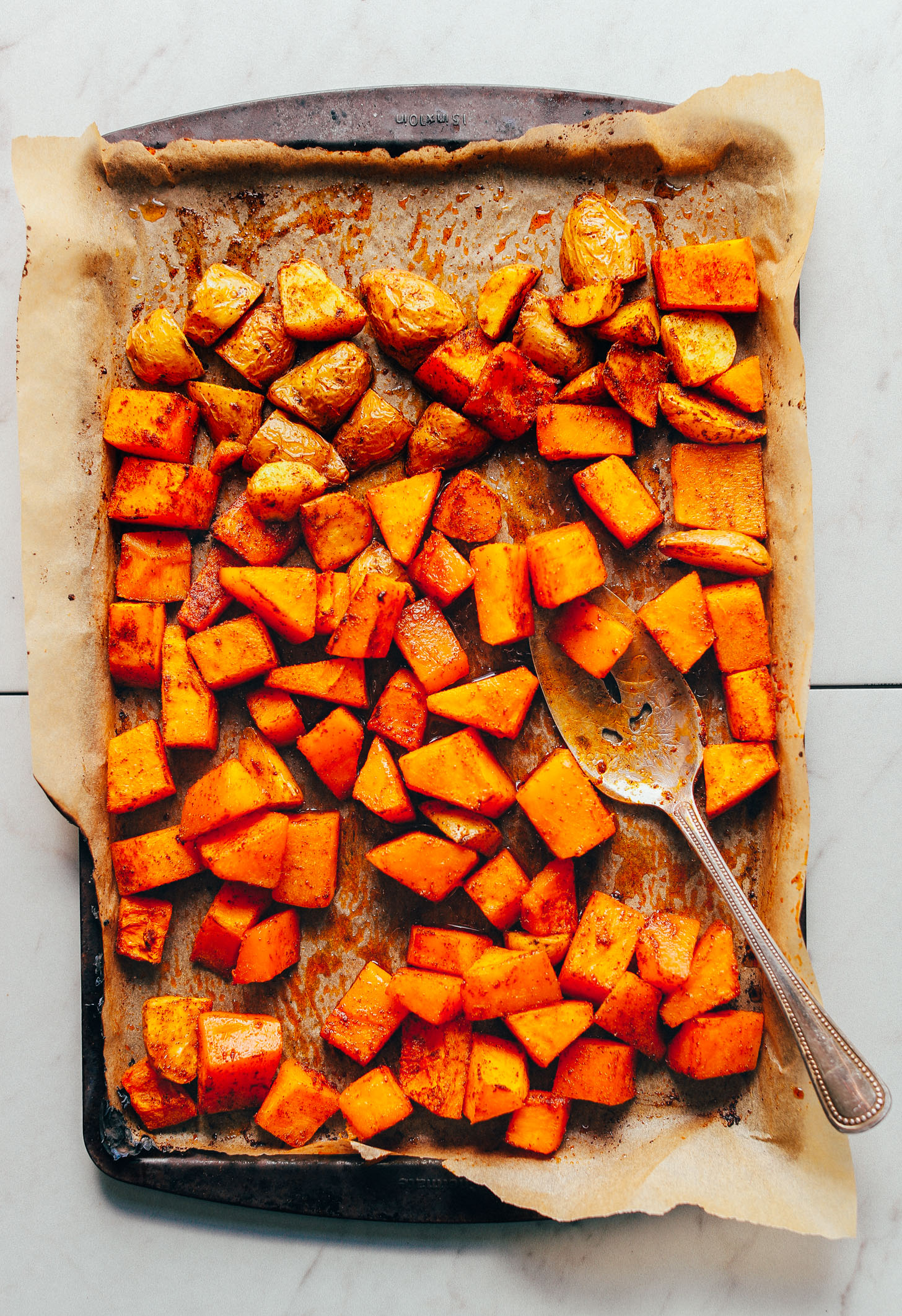 Tray of freshly roasted potatoes and butternut squash