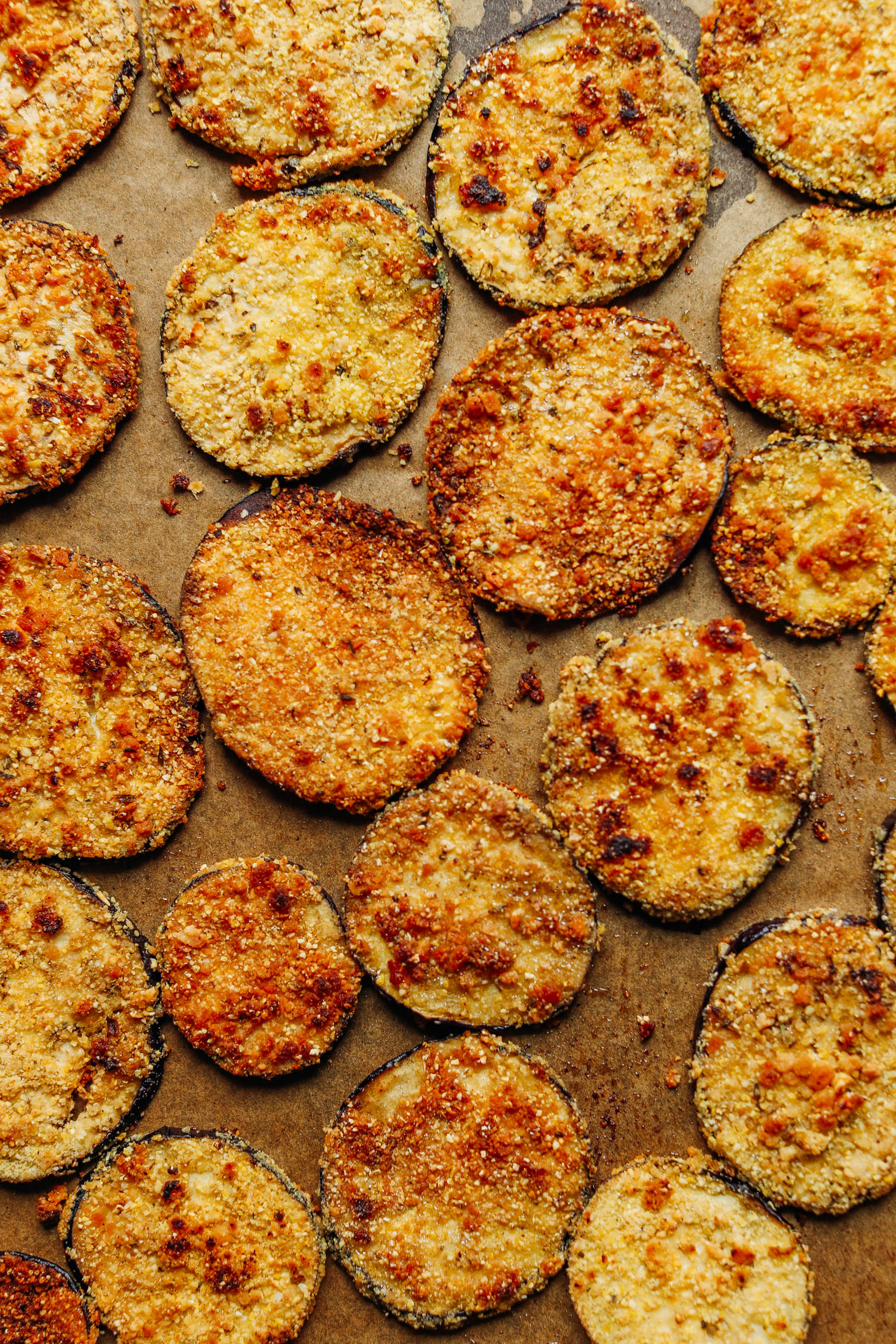 Vegan Gluten-Free Crispy Eggplant Parmesan fresh from the oven on a parchment-lined baking sheet