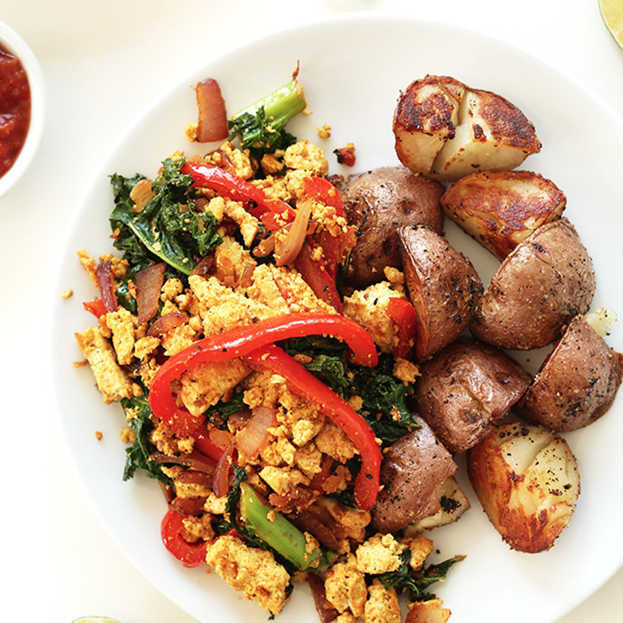 Plate of Southwest Tofu Scramble and Breakfast Potatoes for our roundup of 14 Easy Vegan Breakfast Ideas
