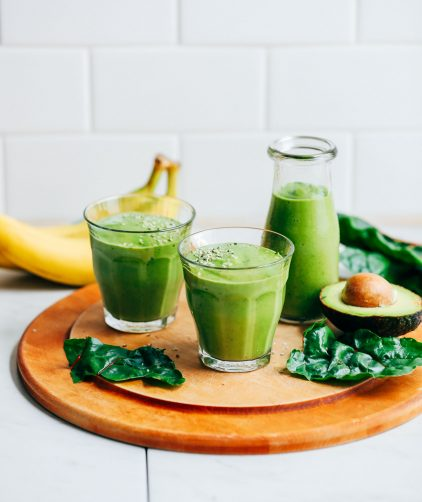 Two glasses and a pouring jug filled with our vibrant gluten-free and vegan Avocado Green Smoothie