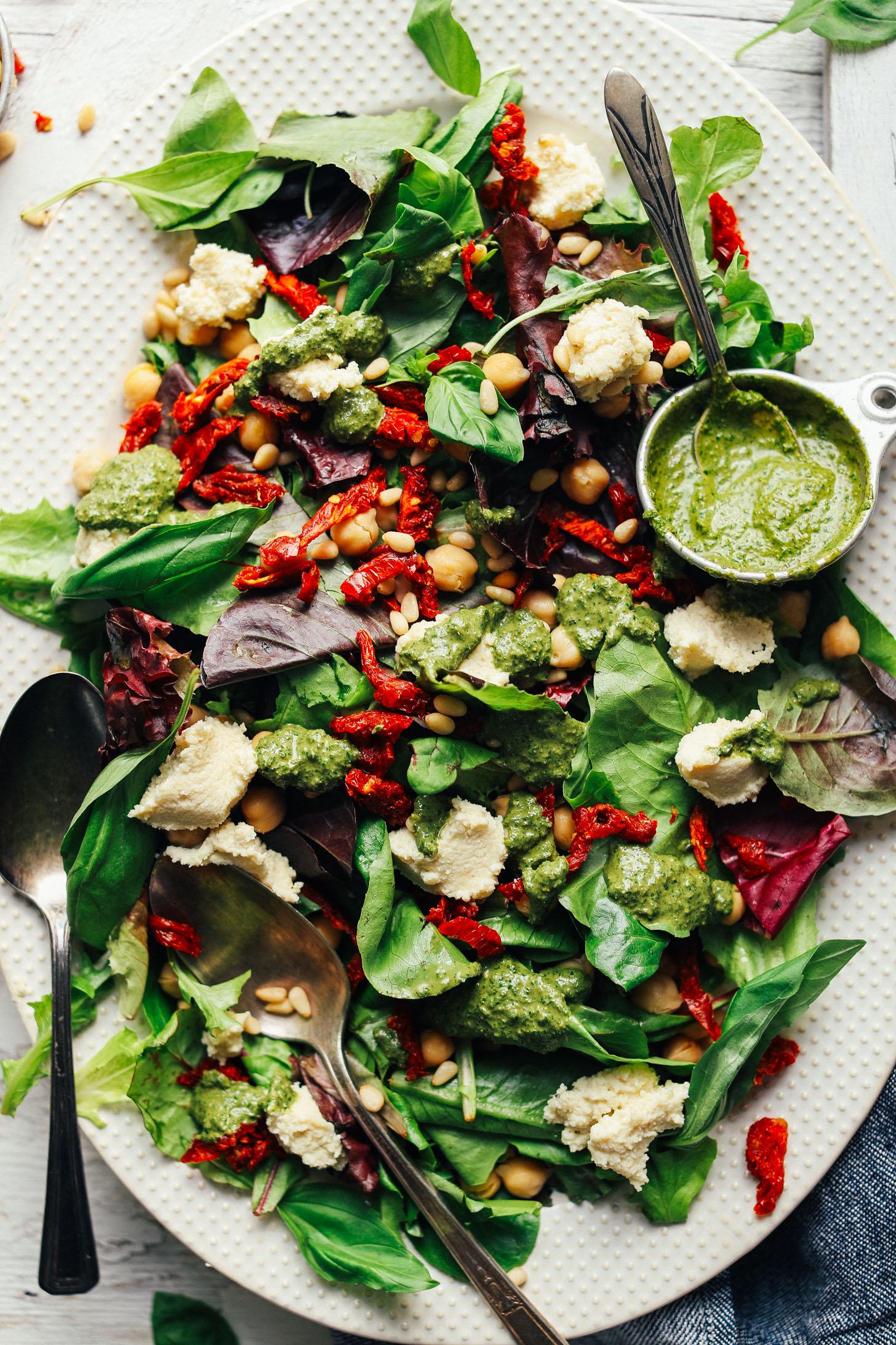 DELICIOUS Green Salad with Almond Ricotta, Vibrant Pesto, and Sun-Dried Tomatoes! 30 minutes, simple ingredients, SO healthy! #vegan #plantbased #pesto #salad #recipe #glutenfree #minimalistbaker