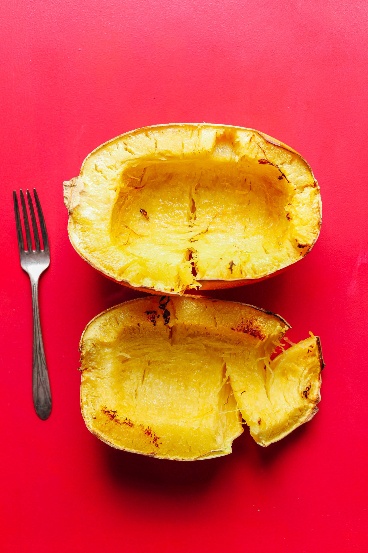 Halved and freshly baked spaghetti squash for our post on How To Roast Spaghetti Squash