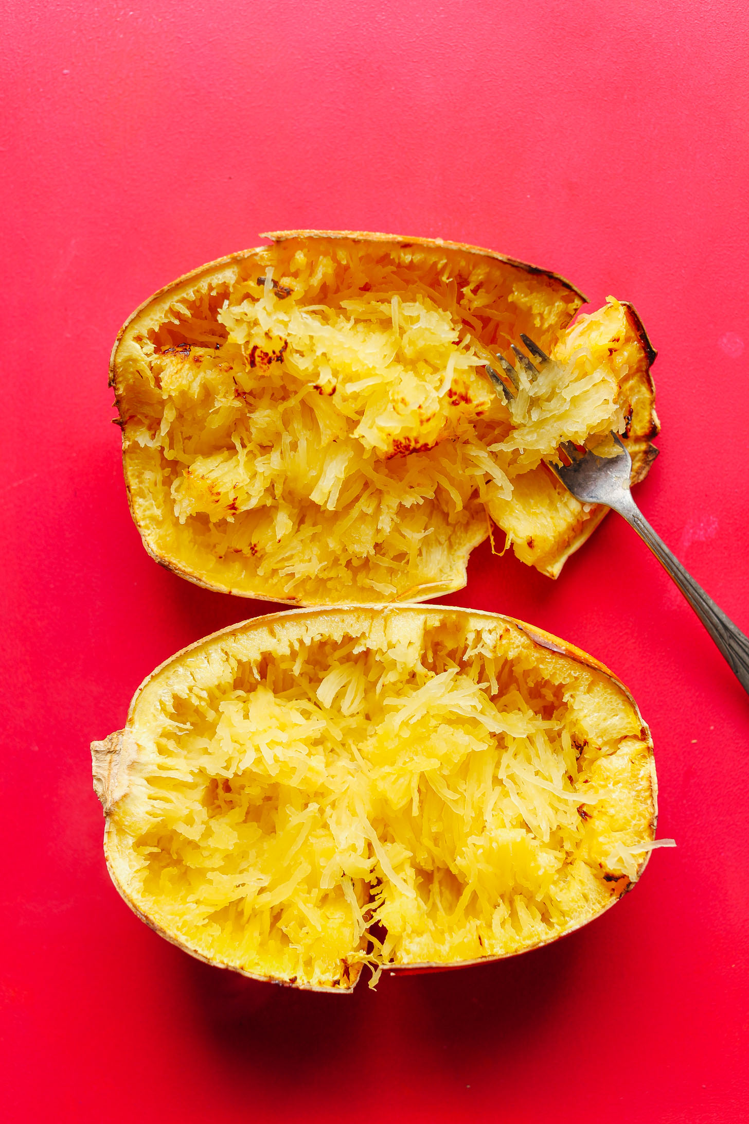 Finely shredded halved spaghetti squash in the skins