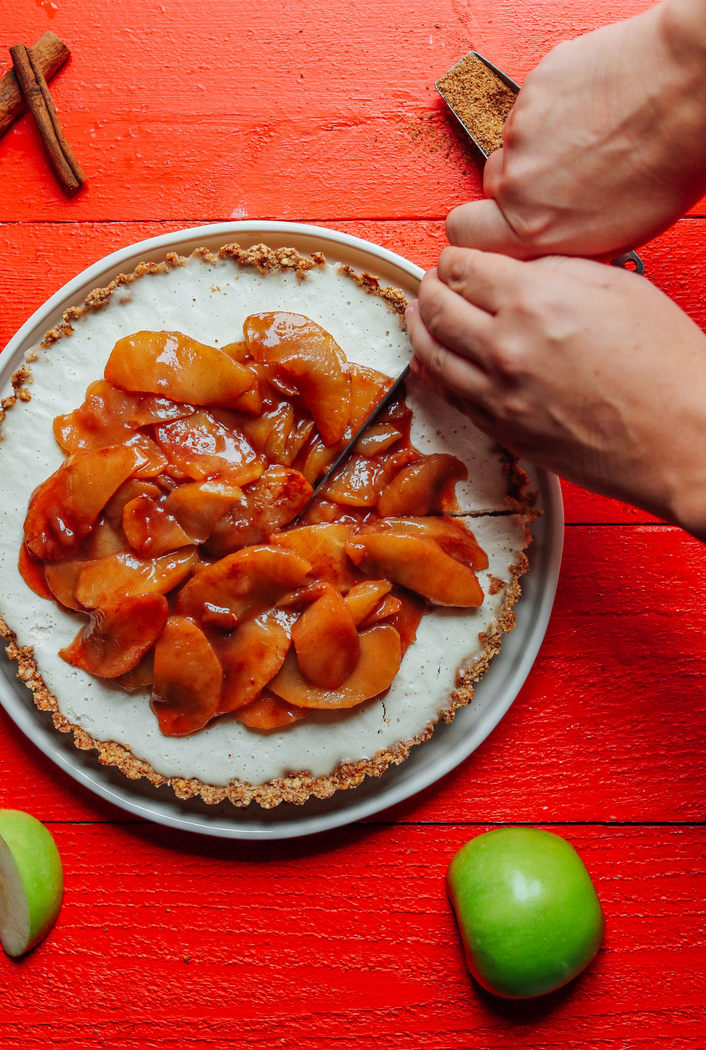 Slicing into our gluten-free vegan Caramel Apple Tart