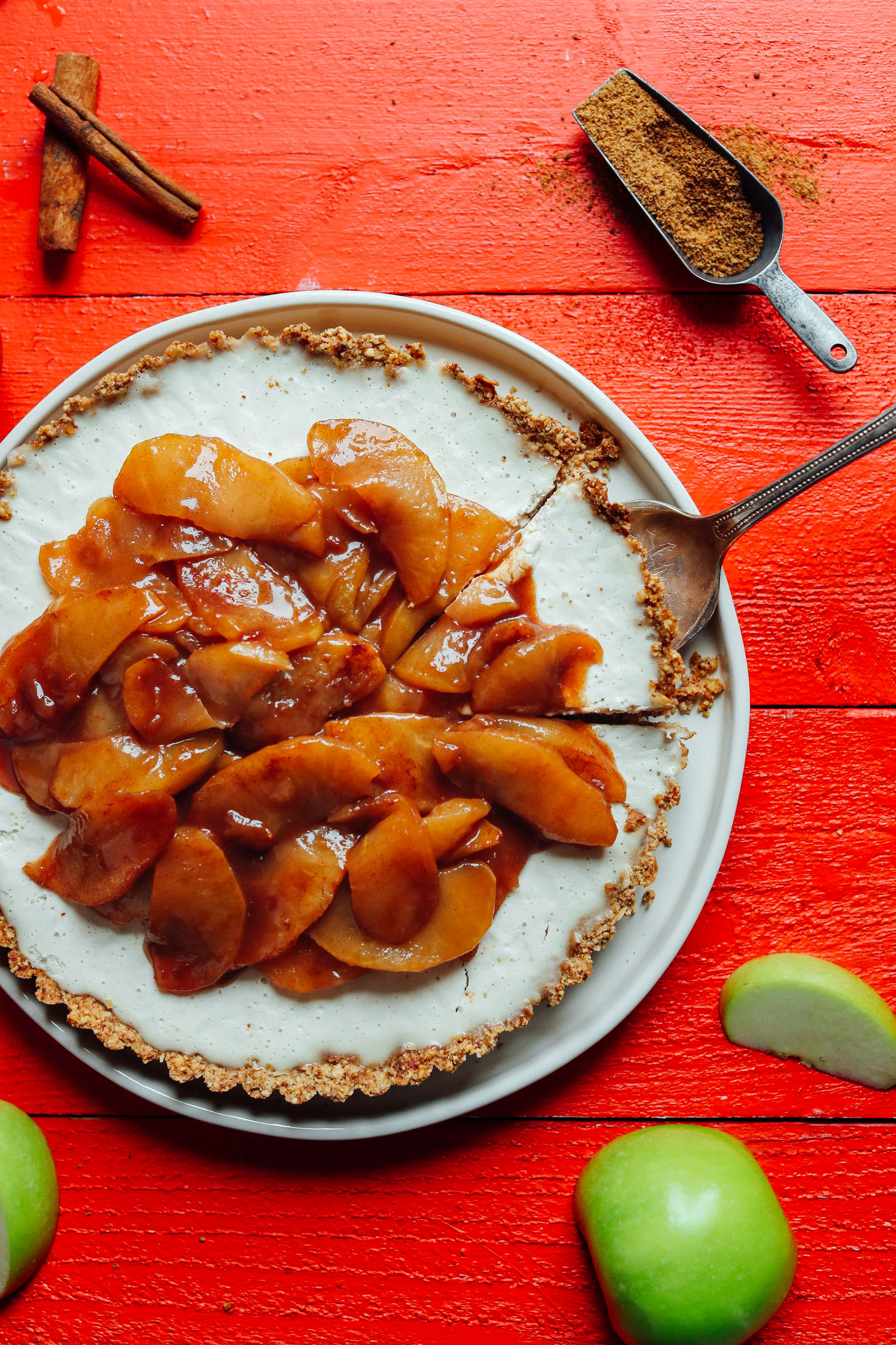 Grabbing a slice of delicious, naturally sweetened Caramel Apple Tart from the serving platter