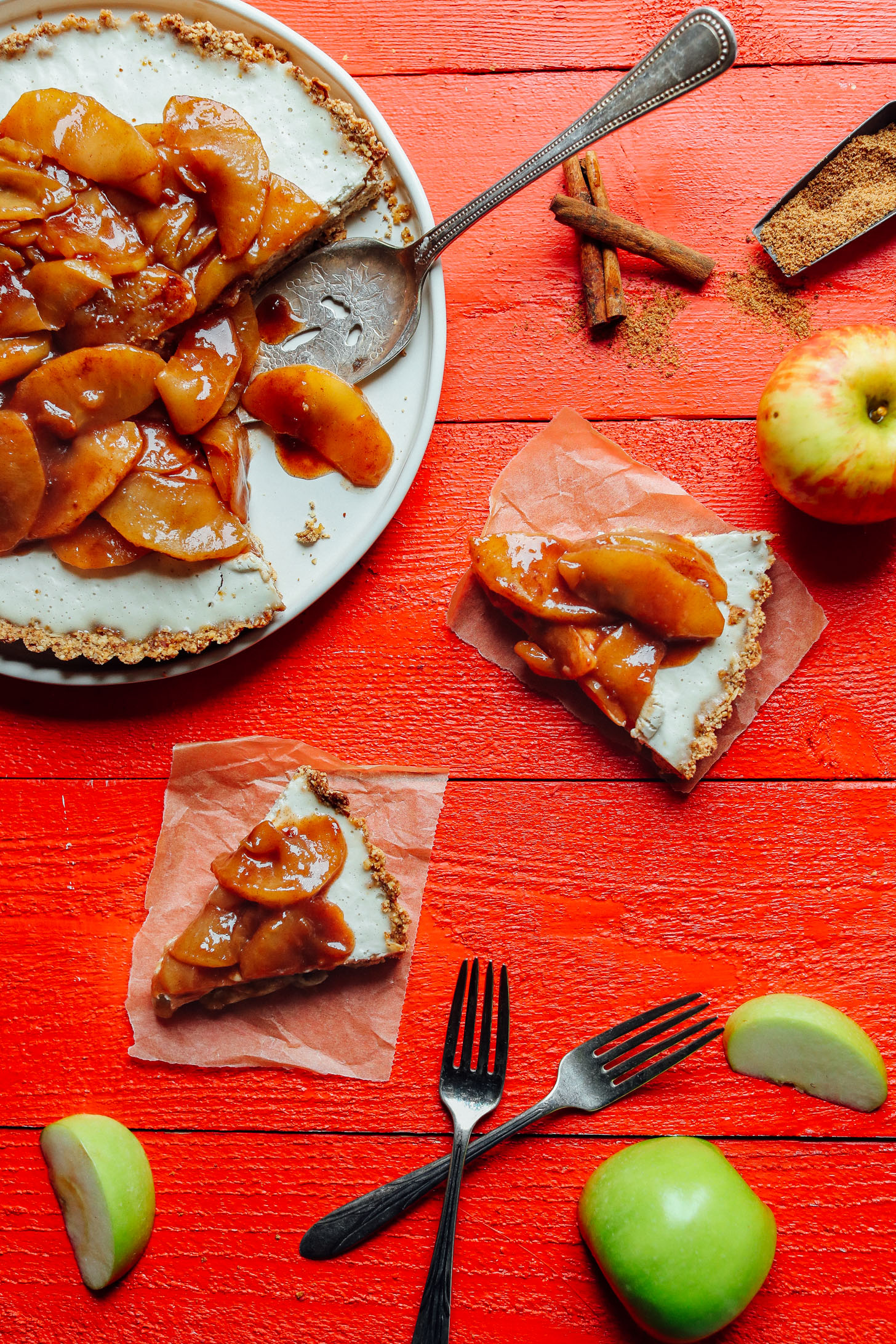 Slices of gluten-free, vegan Caramel Apple Tart on squares of parchment paper