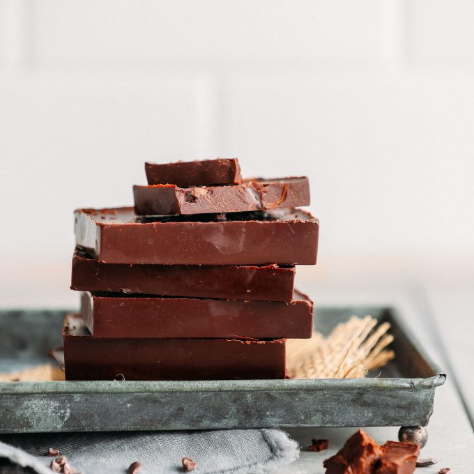 Stack of our favorite rich and creamy DIY Vegan Dark Chocolate bars