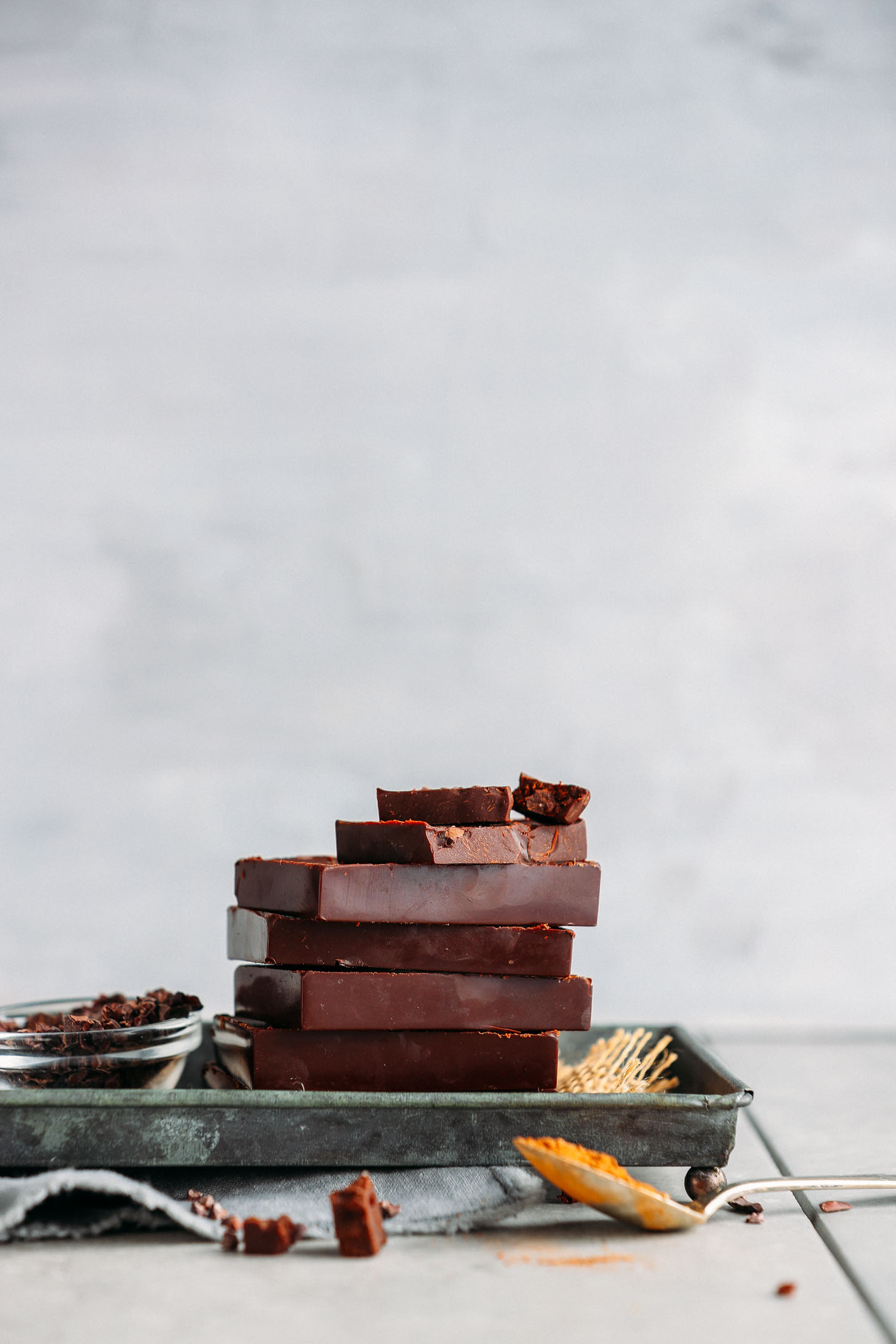 Stack of homemade Vegan Dark Chocolate bars on a metal platter