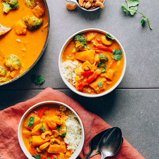 Bowls and skillet of our Amazing Vegan Yellow Pumpkin Curry recipe