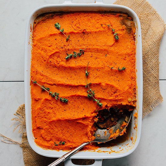 Pan of Vegan Sweet Potato Shepherd's Pie with a spoonful removed
