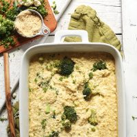 Baking pan filled with a batch of our Cheesy Cauliflower Rice Broccoli Bake for a simple vegan dinner