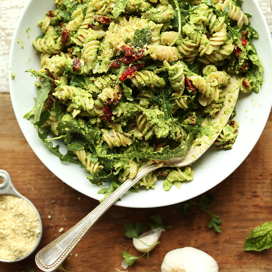 Serving spoon in a big bowl of our 30-Minute Pea Pesto Pasta recipe