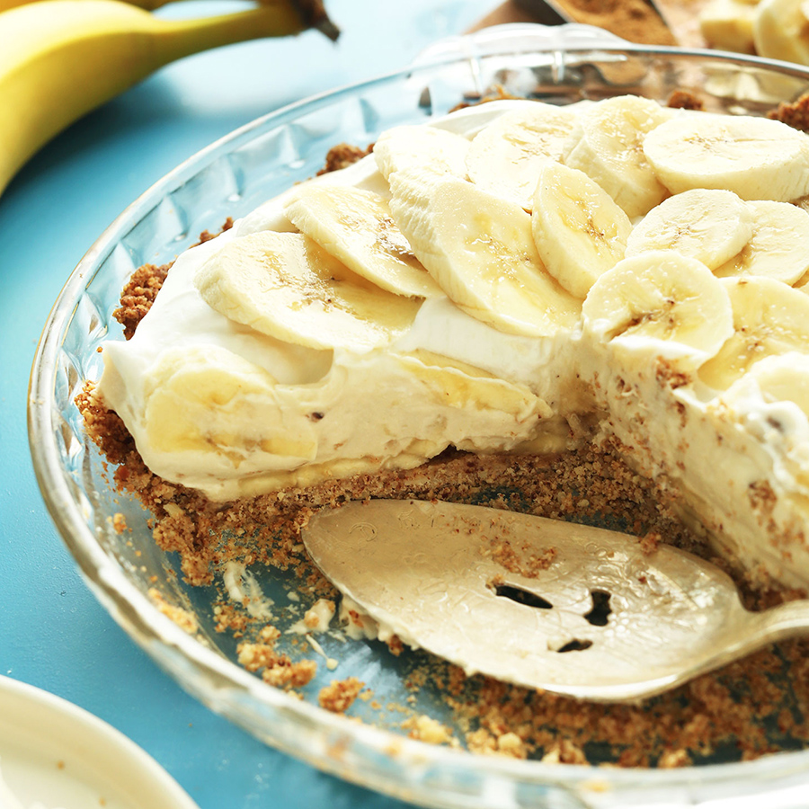 Partial pie pan filled with our gluten-free vegan Banana Cream Pie