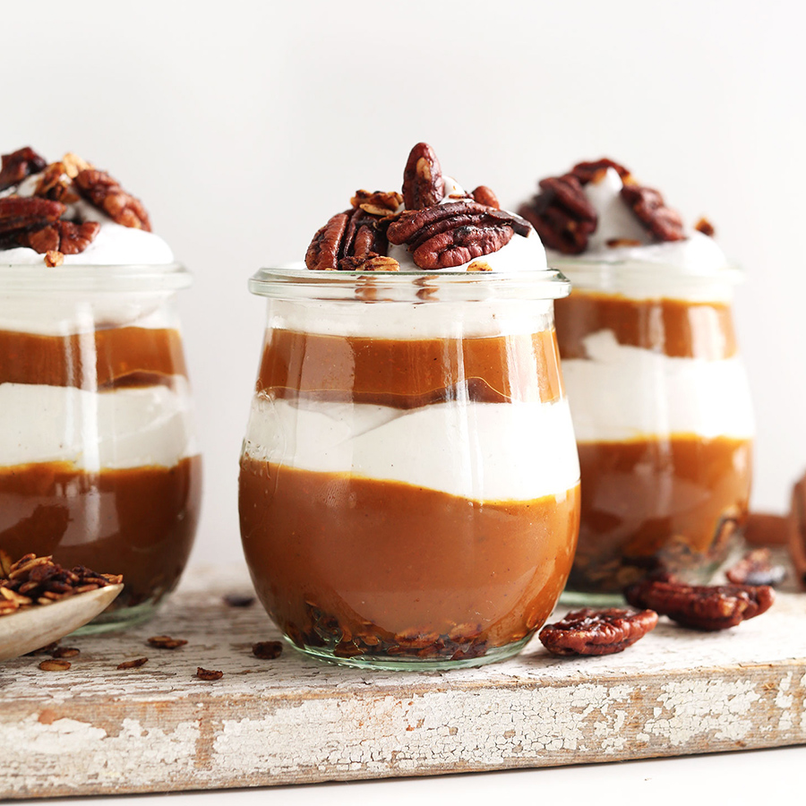 Three glasses filled with our vegan layered Pumpkin Pie Parfaits