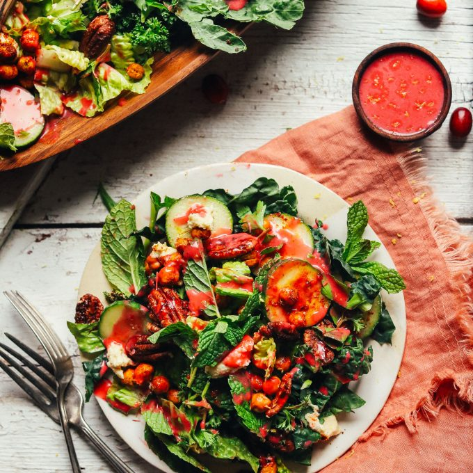 Dinner plate filled with Herbed Green Salad with Cranberry Vinaigrette for a healthy gluten-free plant-based meal