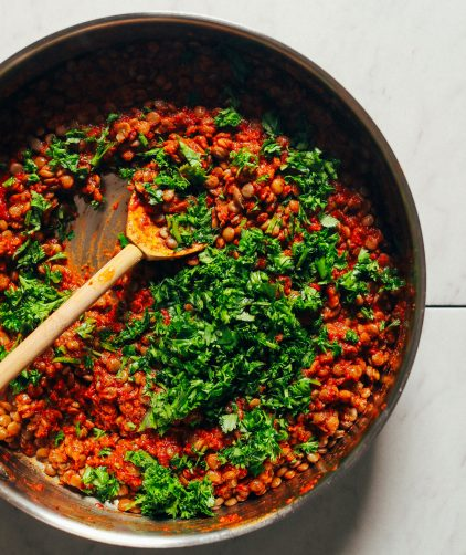 Saute pan with freshly cooked Moroccan-Spiced Lentils as part of a healthy plant-based meal