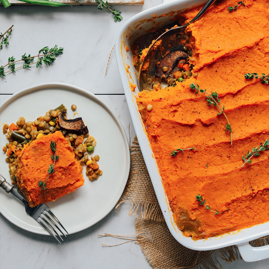 Plate and baking pan filled with our Amazing Sweet Potato Lentil Shepherd's Pie