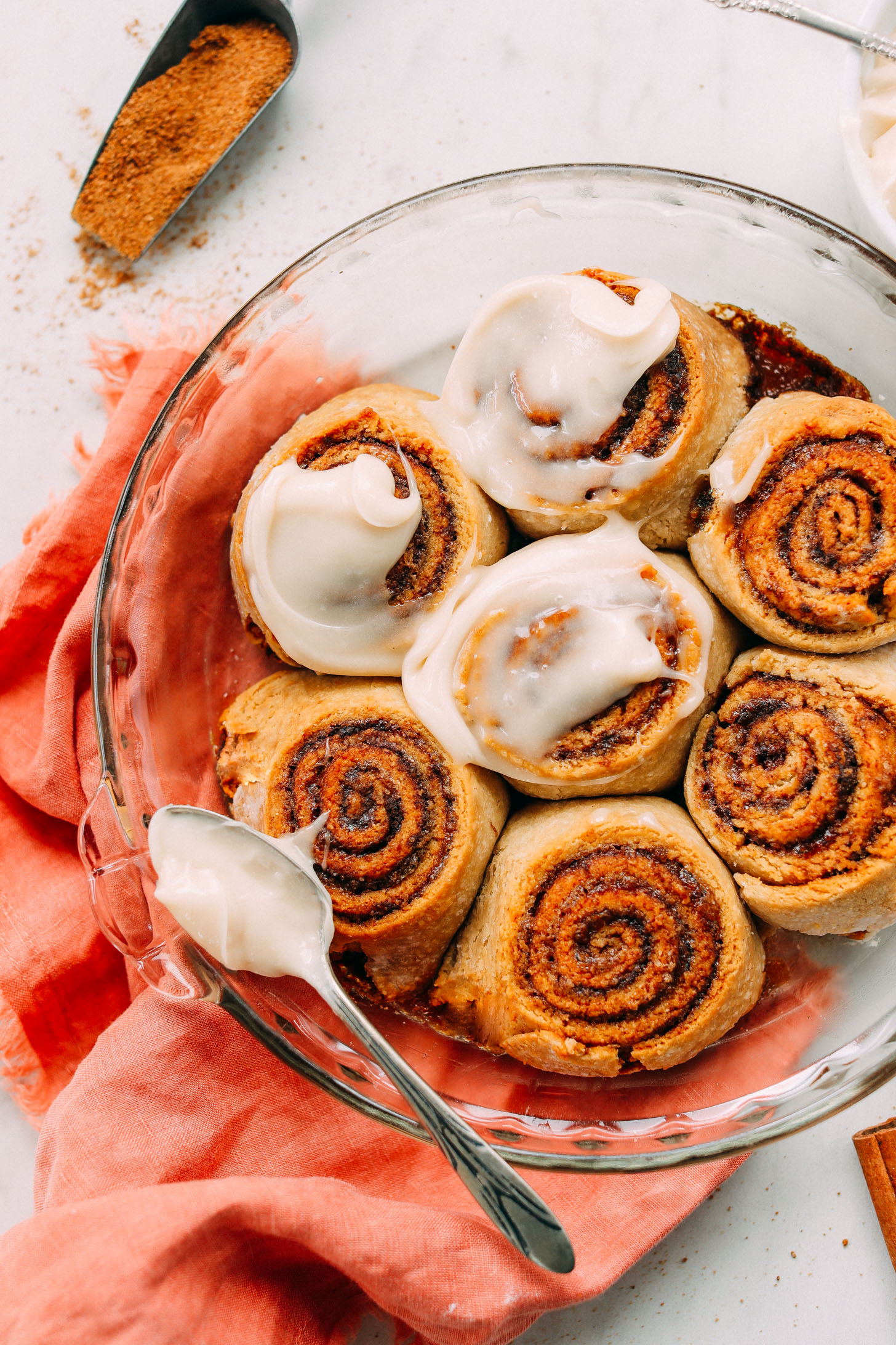 Glass baking dish with delicious Vegan Gluten-Free Cinnamon Rolls with glaze