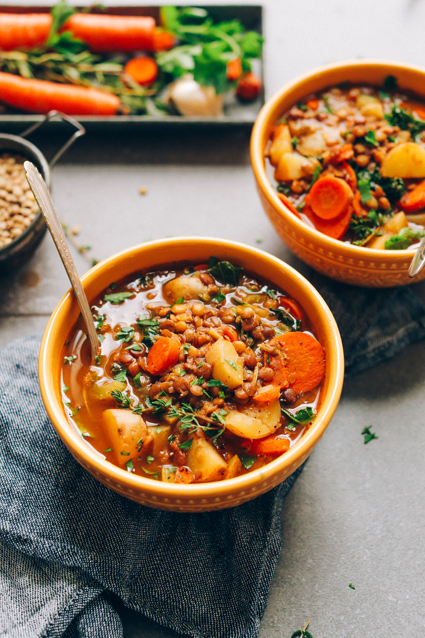 Bowls of our Everyday Lentil Soup recipe garnished with sprigs of fresh thyme