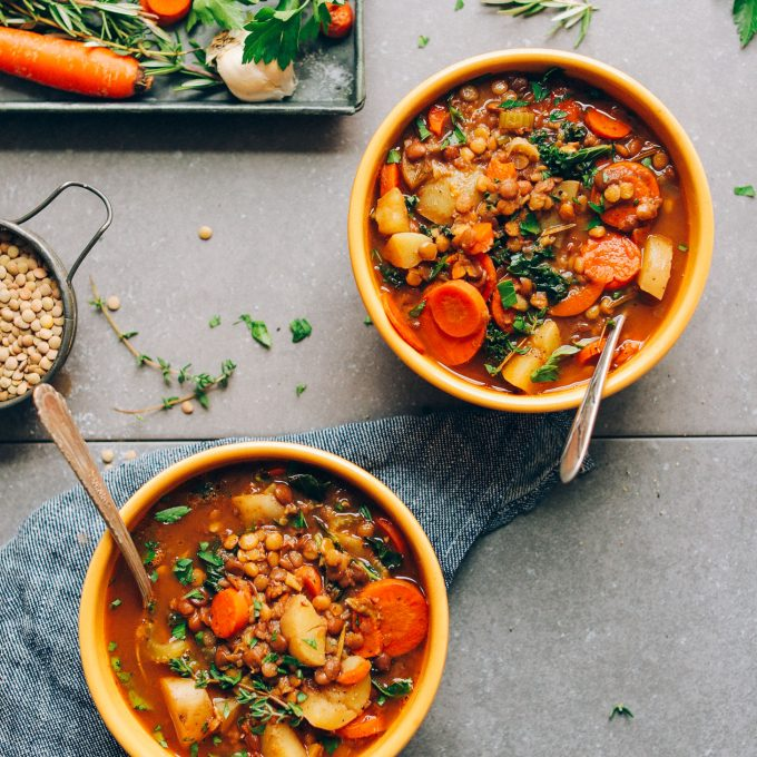 Two yellow serving bowls filled with our EASY gluten-free vegan lentil soup recipe