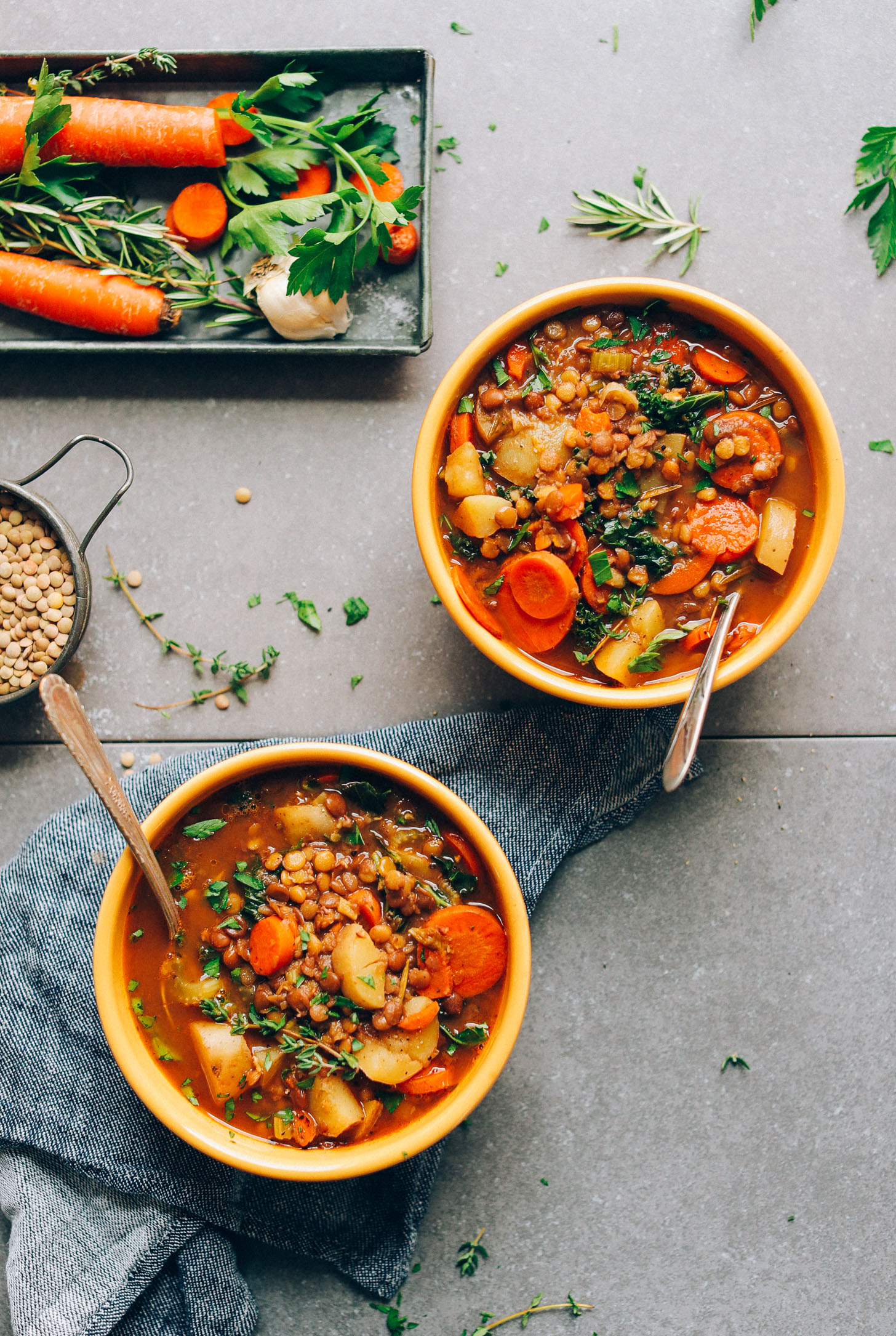 Two bowls of homemade vegetable-packed lentil soup