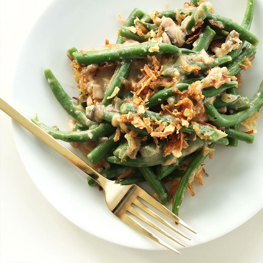 Plate of our Vegan Green Bean Cassrole topped with crispy onions